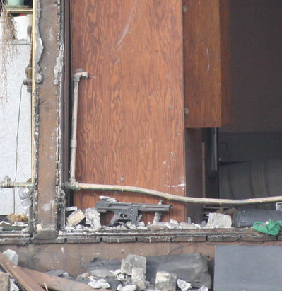 The machine gun can be see among the wreckage of the demolished second floor.