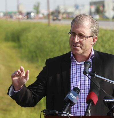 Mayoral candidate Gord Steeves speaks on Kenaston Boulevard Wednesday morning on changes to photo radar.