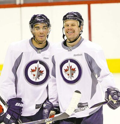 Jets Evander Kane (left) and Olli Jokinen say they're clicking as linemates.