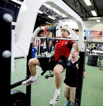 Yaroslavl Lokomotiv's Alex Kruchinin exercises with trainer Steve Saunders during a workout session, Thursday in Manheim, Pa. The Russian hockey club is resuming its transformation far from the Volga River as the team rebuilds after one of the worst aviation disasters in sports history.
