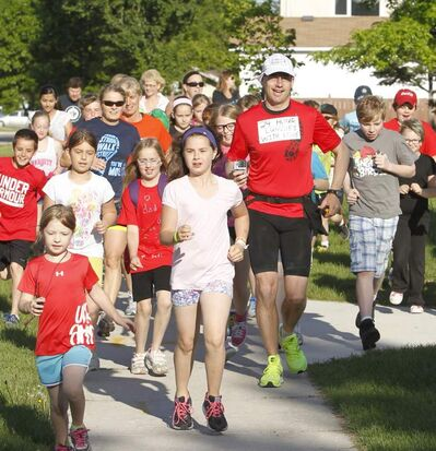 Marathoner Scott Burton, who started running at 8 a.m. sharp Wednesday with a group of children from Beaverlodge Elementary school, completed his 24-hour jaunt.