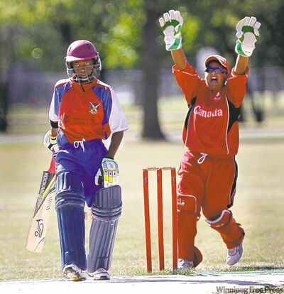 Canadian team wicket keeper Sarbjot Singh celebrates after Canada foils Bermuda batsman Delray Rawlins.