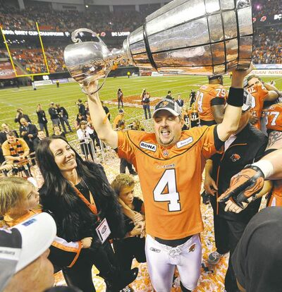 Lions kicker Paul McCallum hoists the Grey Cup after B.C.'s win over the Blue Bombers last year.