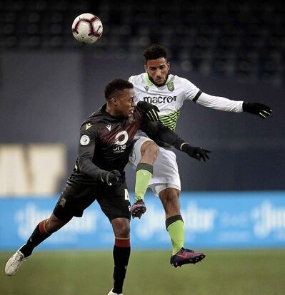 Valour FC's Jorda Murrell and York9 FC's More Doner tangle mid air Wednesday at IG Field.