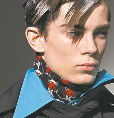 A model wears a creation by Belgian fashion designer Raf Simons.