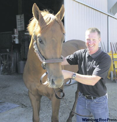 Trainer Chad Torevell with Theglow, a local favourite for the $75,000 Manitoba Lotteries Derby in August.