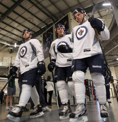 Winnipeg Jets prospects (from left) Lucas Sutter, Mark Scheifele and Scott Komaschuk at the MTS Iceplex.