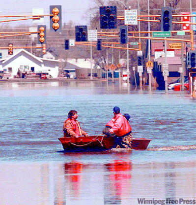 Boating down a street in 1997.