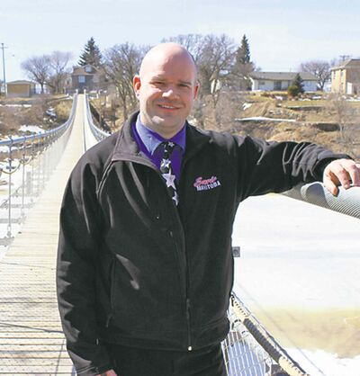 Vern May on the new Souris suspension bridge.