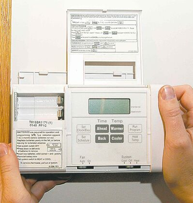 Cutline here for this pic of a programmable thermostat.