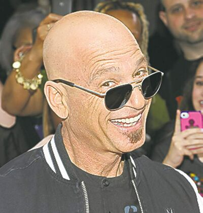 "Celebrity judge Howie Mandel arrives at the ""America's Got Talent"" auditions on Tuesday April 9, 2013 in New York. (Photo by Evan Agostini/Invision/AP)"