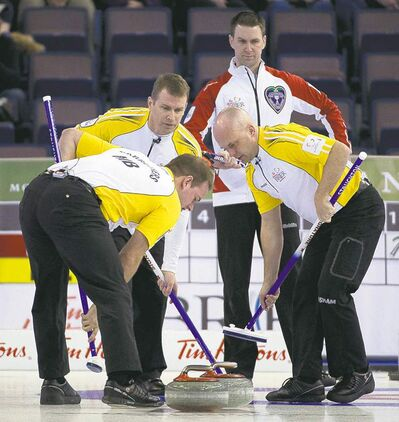 Jonathan Hayward / the canadian pressNewfoundland skip Brad Gushue looks on as Manitoba skip Jeff Stoughton, second Reid Carruthers and third Jon Mead sweep their rock into the house Wednesday.