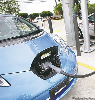 THE DALLAS MORNING NEWS, SOLT / THE ASSOCIATED PRESS  A Nissan Leaf is fuelled up in a U.S. demonstration.