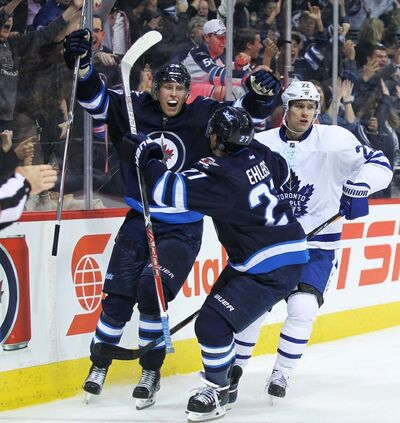 """MIKE DEAL / WINNIPEG FREE PRESS FILES</p> <p>Winnipeg Jets' Patrik Laine celebrates his overtime game-winning hat-trick goal against the Toronto Maple Leafs at MTS Centre in 2016. The game is one of seven of the Jets' """"most iconic games"""" that will be available for online viewing beginning today.</p> <p>""""> </a><figcaption readability="""
