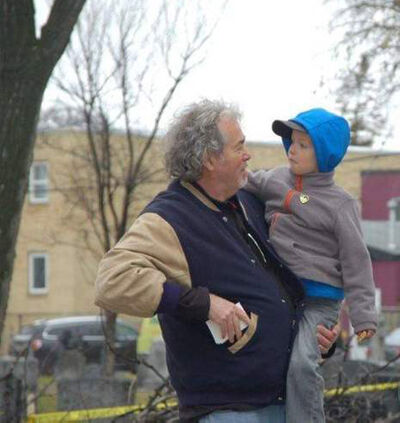 Gordon Sinclair Jr holds his five-year-old grandson, Jacob at Elmwood 