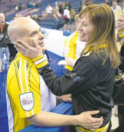 Manitoba third Jon Mead celebrates his team's win with wife Eileen following a Page playoff triumph over Ontario Saturday afternoon.
