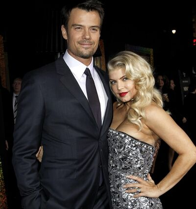 "Josh Duhamel, left, and Fergie arrive at the premiere of ""New Year's Eve"" in Los Angeles on Monday, Dec. 5, 2011. The couple is expecting their first child. THE CANADIAN PRESS/AP-Matt Sayles"