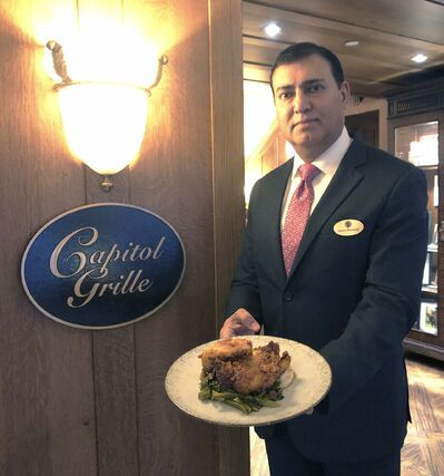 Taylor Allen / Winnipeg Free Press</p><p>Sanjeev Manchanda, the food and beverage manager at the Hermitage Hotel, with the delicious hot chicken served in the hotel's Capitol Grille restaurant. </p></p>