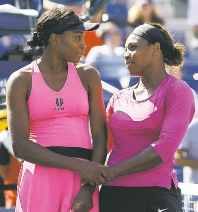 Darron Cummings / the associated press archivesSerena Williams (left) and sister Venus are eying more trophies this year.