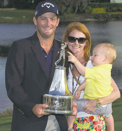 Matt Every with wife Danielle, son Liam and the trophy. Every triumphed at Bay Hill on Sunday.