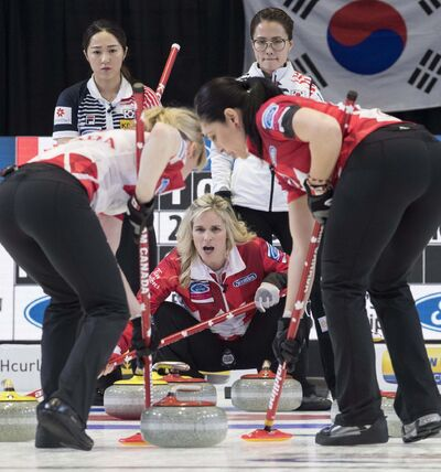 THE CANADIAN PRESS/Paul Chiasson</p><p>Canada skip Jennifer Jones watches a shot come in as Korea skip Kim Eun-jung, right, and third Kim Kyeong-ae look on at the World Women&#39;s Curling Championship Wednesday.</p>