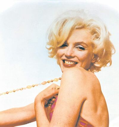 1962 photograph titled Marilyn Monroe: Pulling Beads.