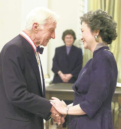 Publisher Jack McClelland is congratulated by Governor General Adrienne Clarkson after being invested into the Order of Canada in 2001.