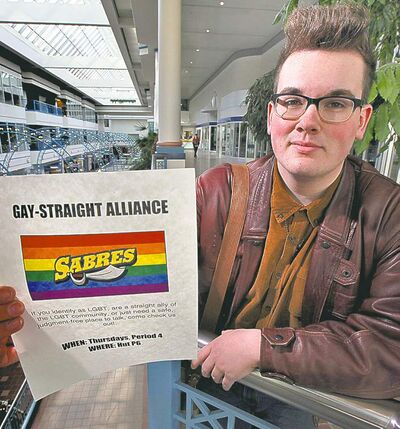 Evan Wiens with the poster he fought to be allowed to distribute in his school.