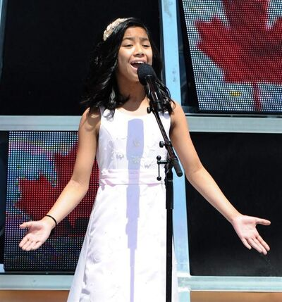 "Maria Aragon, an 11-year-old Winnipeg girl whose rendition of Lady Gaga's ""Born this way"" turned her into an overnight YouTube sensation, has signed a recording deal in the Philippines. Aragon performs Oh Canada during Canada Day festivities on Parliament Hill in Ottawa on Friday, July 1, 2011. THE CANADIAN PRESS/Sean Kilpatrick"