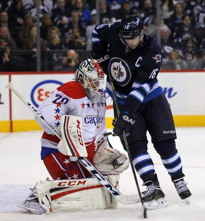 Winnipeg Jets Captain Andrew Ladd battles with Washington Capitals goalie Braden Holtby in a game at the MTS Centre in March. Both Ladd and Holtby are contenders to play on Team Canada.