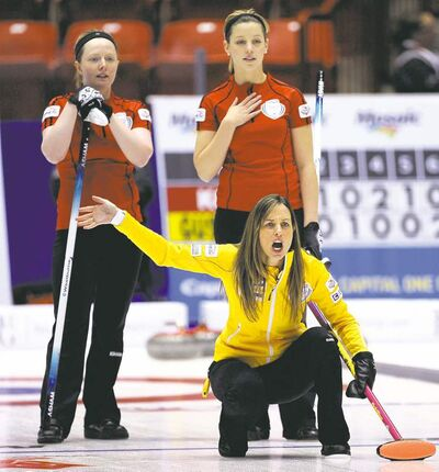 Michael Burns / the canadian pressCalgary skip Crystal Webster waves off her front end as Ashley Howard (left) and Breanne Meakin of the Cathy Overton-Clapham team observe.