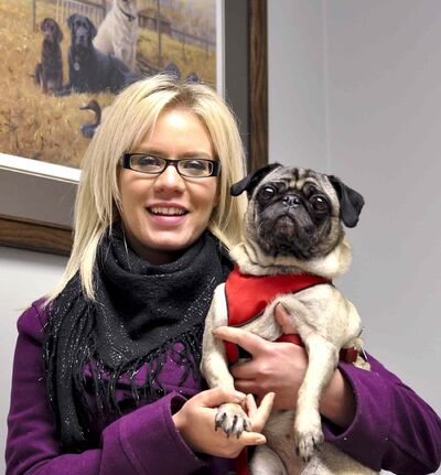 In this 2012 file photo, foster parent Emily Patrician with foster dog, Cassie, who has since been adopted.