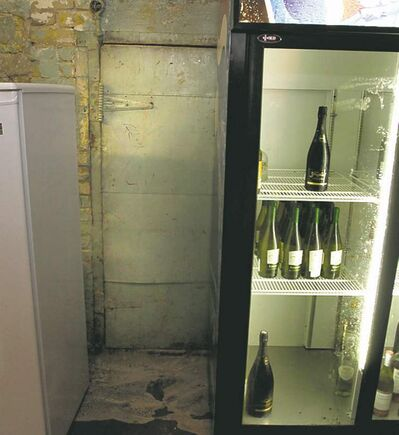 WAYNE GLOWACKI / WINNIPEG FREE PRESS  Shove the wine fridge aside at Don Pedro's Mexican Grill and two padlocked doors are the old tunnel's only seal.
