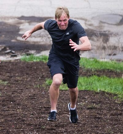 Daniel Crump / Winnipeg Free Press Files</p><p>Fitness coach Richard Burr races up a steep incline at Winnipeg's Westview Park. Burr is a former Blue Bombers trainer who now operates his own athletic therapy business.</p>