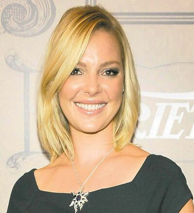 FILE - In this Oct. 5, 2012 file photo, actress Katherine Heigl poses at Variety's 4th annual Power of Women event in Beverly Hills, Calif. Heigl has channeled her love of animals to ending animal abuse. She's launching a line of pet products called Just One where portions of the proceeds go to help programs that foster, train, neuter and rescue animals. (Photo by Chris Pizzello/Invision/AP, File)