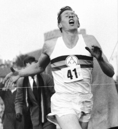 Roger Bannister breaks the tape 60 years ago.