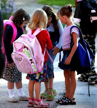 From left, Shelby, Hailey, Paige and Abygale check out their back to school outfits on their  first day of Grade One.  (Wayne Glowacki / Winnipeg Free Press)