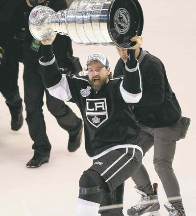 Richard Mackson / USA TODAY Sports Conn Smythe Trophy winner as playoffs MVP Justin Williams carries the Stanley Cup around the rink after the Kings clinched the title Friday night.