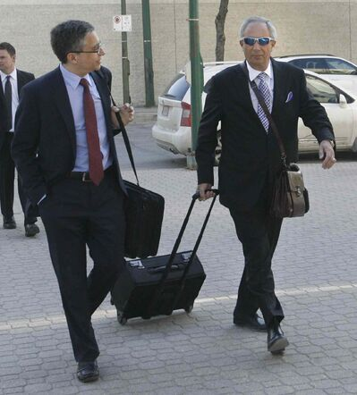 Lawyers Robert Tapper, at right and Jonathan Kroft arrive at the Law Courts Wednesday morning for the PST court case.