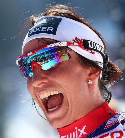 Marit Bjoergen, of Norway, celebrates after winning the women's cross country 30 km Mass Start of the Nordic Ski World Championships in Val di Fiemme, Italy, Saturday, March 2, 2013. (AP Photo/Giovanni Auletta)