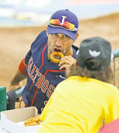 Chris Wiebe, 11, was kind enough to share an onion ring with Saltdogs outfielder Daniel Carroll just before the game was called.
