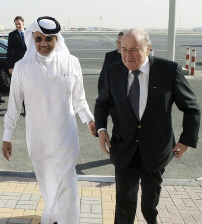 FILE - In this file photo dated Thursday Dec. 16, 2010, showing FIFA President Sepp Blatter, right, being welcomed by AFC president Mohammed bin Hammam upon his arrival in Doha, Qatar. FIFA's executive committee meets Thursday Oct. 3, 2013 and Friday Oct. 4 at the headquarters of the football governing body in Zurich and plans to discuss the scheduling of the 2022 World Cup in Qatar. (AP Photo/Osama Faisal, file)