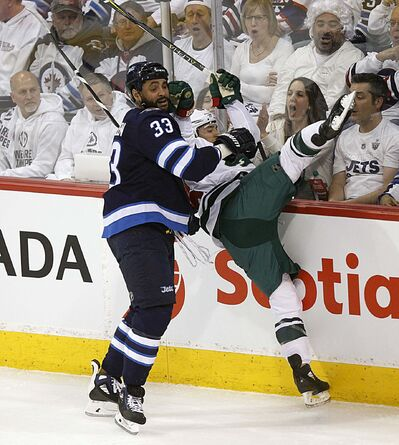 PHIL HOSSACK / WINNIPEG FREE PRESS</p><p>Winnipeg Jets&#39; Dustin Byfuglien takes out Minnesota Wild&#39;s Jared Spurgeon Wednesday.</p>