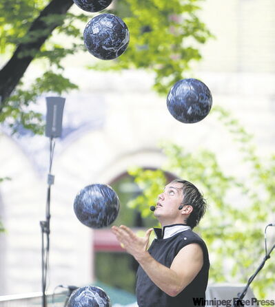 Victor Rubilar keeps a keen eye on his fringe fest performance at the outdoor stage.