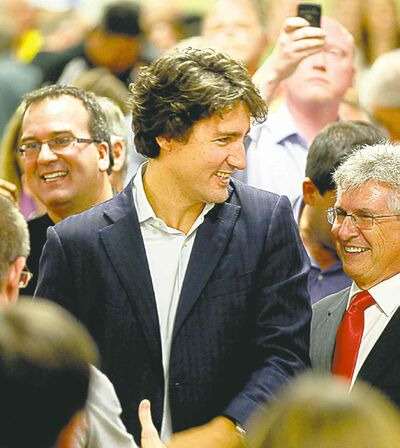 Trudeau with acclaimed candidate Hayward (right).