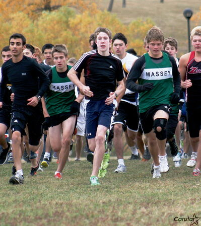Keegan Jackson (left, in green jersey) and David Friesen, pictured here running for Vincent Massey, were called into a different duty at the provincial championships.