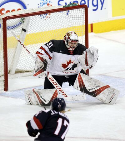 PHIL HOSSACK / WINNIPEG FREE PRESS</p><p>Team Canada goalie Genevieve LaCasse reacts as a slap shot from Team USA&#39;s Jocelyne Lamoureaux-Davidson deflects off her pad.</p>