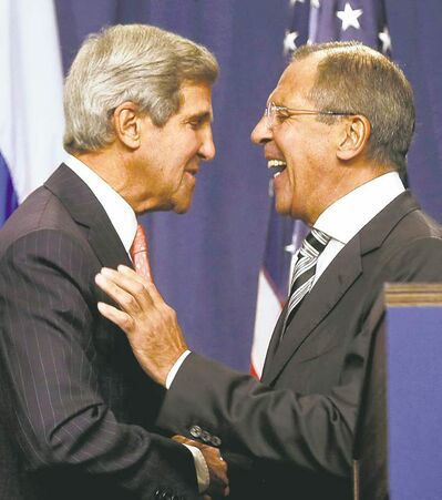 Larry Downing, The Associated PressU.S. Secretary of State John Kerry, left, and Russian Foreign Minister Sergei Lavrov shake hands during a news conference following meetings regarding Syria in Geneva, Switzerland, on Saturday.