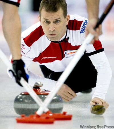 Skip Jeff Stoughton throws against Team Howard in round robin on way to a 5-4 loss. He expects a winning result today.