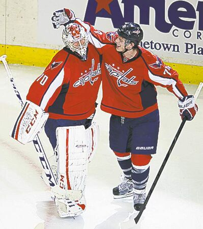 Braden Holtby gets some love from  John Carlson after OT win Saturday.